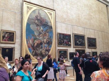 Some of the many paintings surrounding the Mona Lisa.